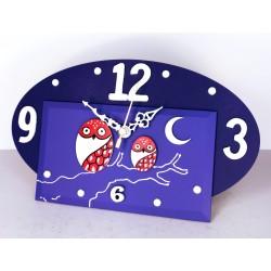 11. Reloj ovalado madera y cristal 14x24cm. Búhos rojos.