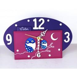 10. Reloj ovalado madera y cristal 14x24cm. Búhos azules.