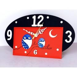 12. Reloj ovalado madera y cristal 14x24cm. Búhos azules.