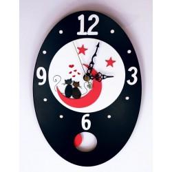 34.Reloj de pared ovalado...