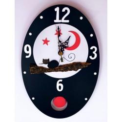 44.Reloj de pared ovalado...