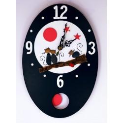 35.Reloj de pared ovalado...