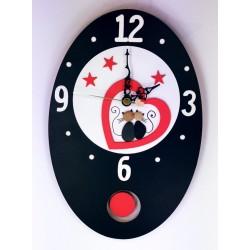 37.Reloj de pared ovalado...